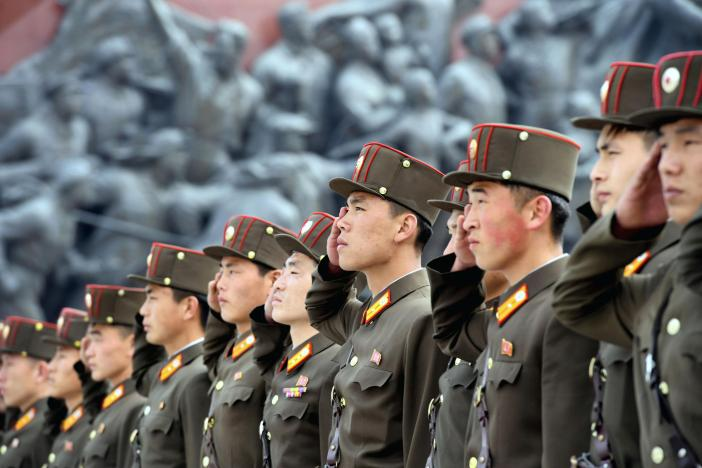 North Korean soldiers salute bronze statues (not pictured) of North Korea's late founder Kim Il-sung and late leader Kim Jong Il at Mansudae in Pyongyang, in this photo released by Kyodo April 25, 2017, to mark the 85th anniversary of the founding of the Korean People's Army. Mandatory credit Kyodo/via REUTERS